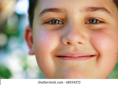 Nice portrait of the little boy smiling under the summer sun