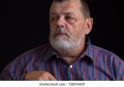 Nice portrait of a thoughtful senior man in striped shirt