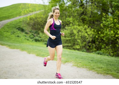 A nice portrait of a woman jogging outdoors