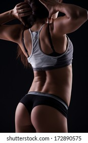 Nice Portrait of Woman's Back, in black sports clothing.