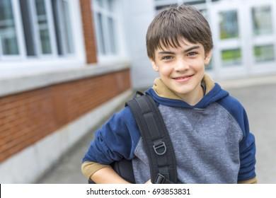 A Nice Pre-teen boy outside at school having good time