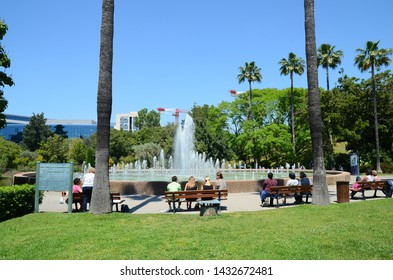 Nice, Provance/France - 06/03/2019: people rest opposite the fountain in the city park Fenix