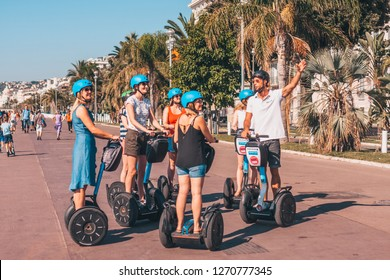 Nice, Provence / France - September 29, 2018: A tour guide on a hoverboard segway shows a city to tourists