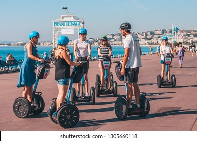 Nice, Provence / France - September 29, 2018: Tour group moves around the city on hoverboard segway
