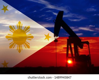 Nice pumpjack oil extraction and cloudy sky in sunset with the Philippines flag.
