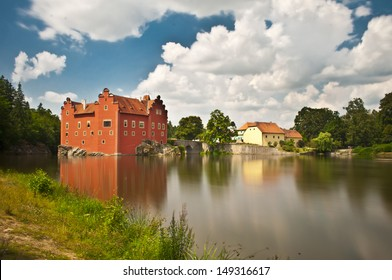 nice red castle near water lake
