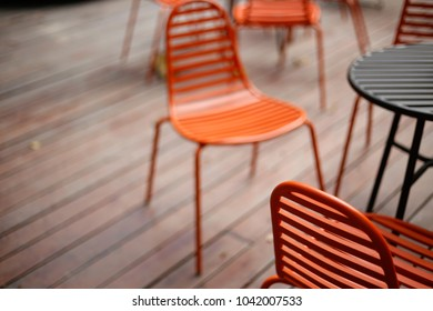 Nice red chairs and table set  in the cafe garden, sofe focus&bl
