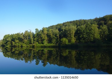 Nice reflection in calm water of a river