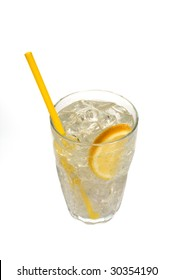 A nice refreshing glass of lemonade with a slice of lemon and a yellow straw, sweating with beads of water.