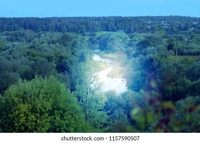 Nice rural photo of nature from above and a river lit by the sun
