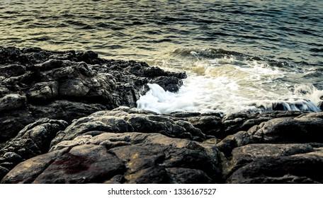 Nice sea surf splashing at rock