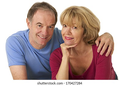 nice senior  couple on a white background looking to camera