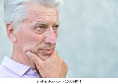nice senior man on a gray background