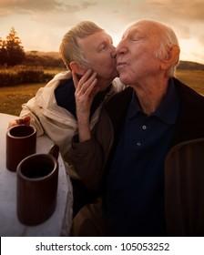 Nice senior woman kisses her husband outside