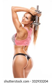 Nice sexy woman doing workout with dumbbell isolated over white background