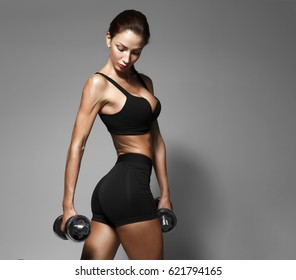 Nice sexy woman doing workout with dumbbells