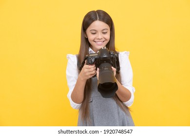 nice shot. school of photography. hobby or future career. photographer beginner with modern camera. making video. childhood. teen girl taking photo. kid use digital camera. happy child photographing.