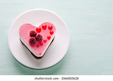 nice small cake in the form of heart  on the table
