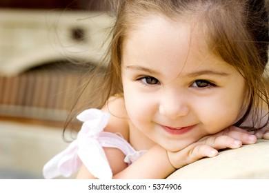 Nice small girl looking at camera