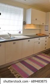 Nice small kitchen. Beautiful house studio, interior, view of the Kitchen, Modern, Modern Studio Apartment. Kitchen, Hand woven mat, Norway Handcrafted. beautiful colorful hand made motley rug