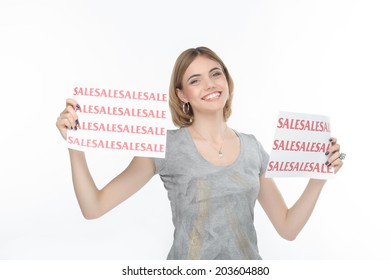 Nice smiling blonde keeping two posters with SALE on it. Isolated on the white background