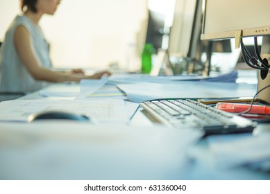 Nice soft focus image of a messy desk.