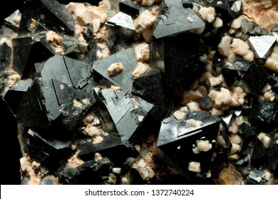 Nice specimen of Magnetite, is largely covered with sharp octahedra of magnetite associated with sharp, smaller, creamy, off-white crystals of a feldspar.