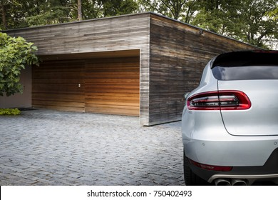 Nice sport SUV car in front of a garage on the countryside