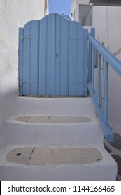 Nice Stairs That End In Typical Blue Doors In The Picturesque Streets Very Narrow In Chora Island Of Mikonos .Arte History Architecture July 3, 2018. Chora, Mykonos Island, Greece.