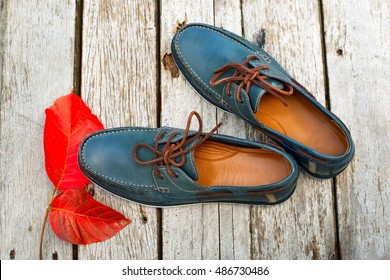 Nice style male shoes on wooden background.top view