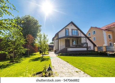 Nice summer cottage with green lawn