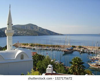 Nice summer morning, view of the Kalkan Marina with many yachts and boats from a hotel terrace. Kalkan is a small town on the Turkish Mediterranean coast and an famous tourist destination