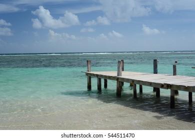 Nice sunny day at the beach. Pier on a beach of Costa Maya.