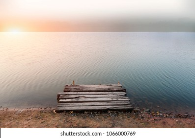 Nice sunset in horizental line of lakes and nature. Fishing background. Nature wild area dock over the river the island.