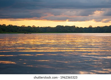 Nice sunset on the Amazon River watching indigenous boats.