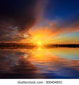 Nice sunset scene over lake water surface