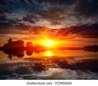 Nice sunset scene with sun over lake