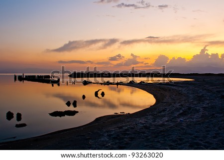 Nice sunset/twilight with reflection on a desert lake. Bombay Beach at the Salton Sea. Abandoned harbor.
