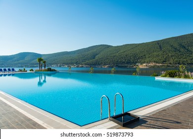 Nice swimming pool outdoors on bright summer day