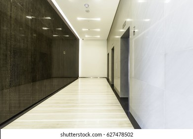 Nice symmetrical image of a generic lift lobby in a private building.