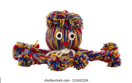 Nice sympatico nice octopus devilfish made of colorful woolen threads isolated on white background. Handmade home decor.