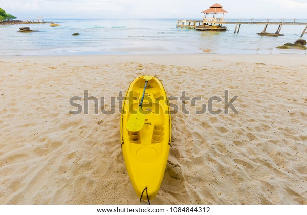 Nice tropical white sand beach with kayak boat in island, Thailand