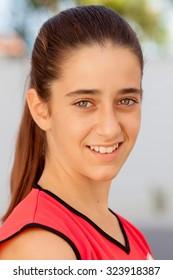 Nice twelve years old girl with brown eyes outdoor