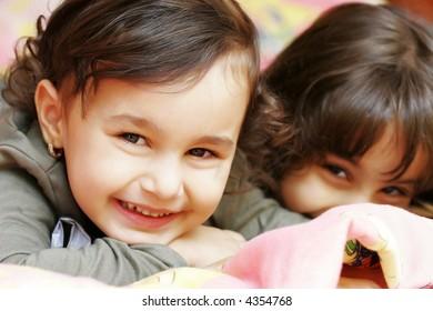 Nice two small girls looking at camera