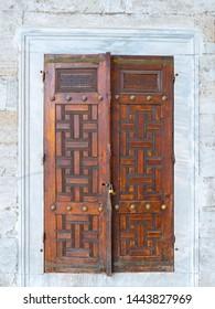 Nice unlocked old wooden door .