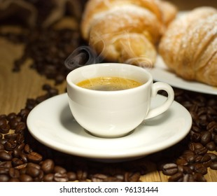 nice view of coffee cup with croissant