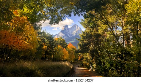 Nice view of the Pedraforca mountain between trees on a path in Catalonia.