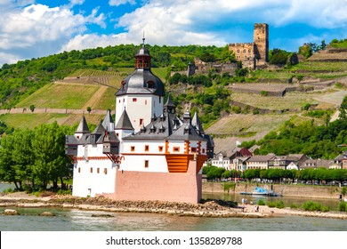 Nice view of Pfalzgrafenstein Castle,  a toll castle on Falkenau island in the Rhine river & Gutenfels Castle in the background. Both castles are part of the Rhine Gorge, a UNESCO World Heritage Site.