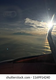 Nice view of sun rays at the tip of aeroplane wing from the window