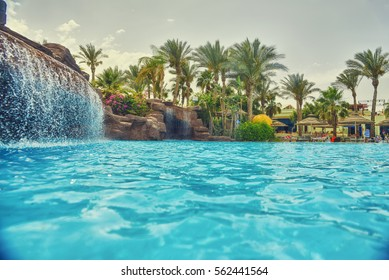 nice view of the swimming pool with waterfall